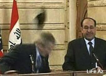 В Багдаде в Джорджа Буша швырнули ботинки - [Фото]